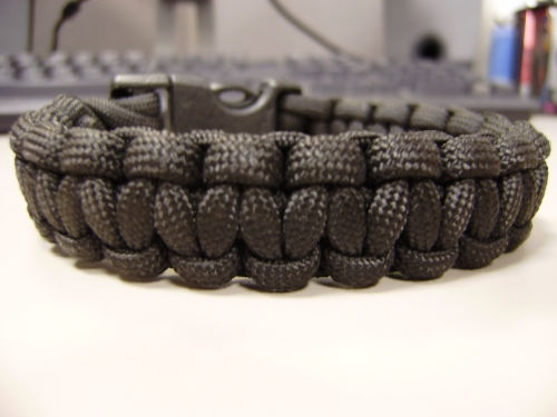 "A braclet I made using Military Paracord.  The knot is called a ""King Cobra Stitch""  I stole the buckle off of my CamelBack."